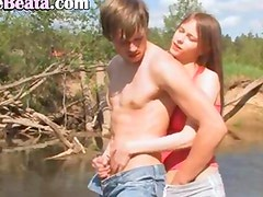 Young couple loving by the lake