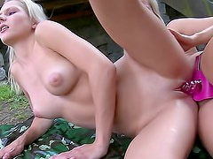 Sporty boxing babes have strapon sex outdoors
