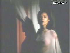 Barbara Carrera In a See-Through Dress