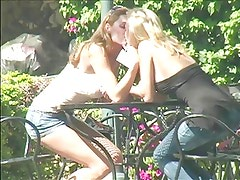 2 young blonde lesbians making out on a terras