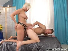 Pretty blonde girl fucks a guy in his ass with strap on