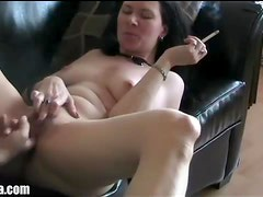 He licks and fingers her hole while she smokes