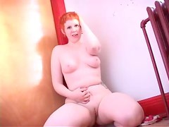 Chubby redhead with short hair showing off her fair skin