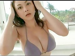 Big boobed Asian teases you with her body