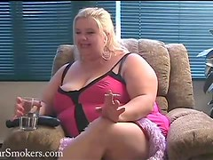 Big busty blonde BBW having a smoke on her couch