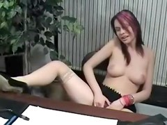 Seductive office babe fingering herself in the office