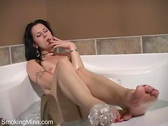 Quick striptease and smoking in the bathtub