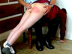 Schoolgirl in sweater spanked on ass