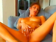 Slender solo redhead with nice tits
