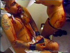 Brunette Dominatrix With Giant Jugs Whips and Punishes Submissive Male