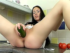 Big Breasted Brunette Masturbating With a Cucumber In the Kitchen