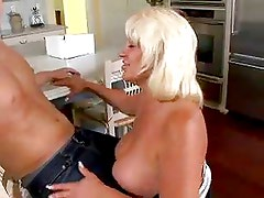 Mature and voluptuous woman a great lover of young guys