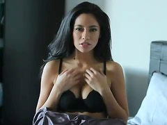 Latina in the bedroom brings out her big tits