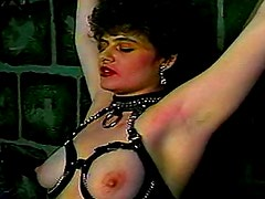 Retro bondage video with leather slut