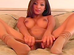 Busty Asian in pantyhose talks naughty
