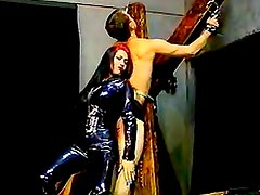 Shiny latex catsuit on spanking mistress