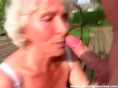 Granny sucks him off outdoors