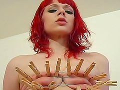 Skinny redhead submits to severe pain