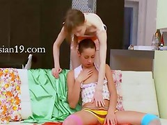 Two polish chicks play with strong man