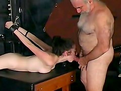 Naked old man fucks BDSM slave
