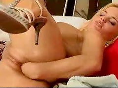 Blonde babe in fisting action