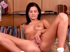 Brown-haired hottie plays with her pussy in her father's study