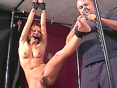 Flexible gagged girl bound in dungeon