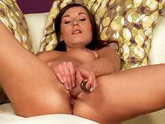 Brown-haired hottie fingers her juicy pussy and drills it with a dildo