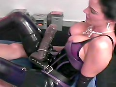 Latex mistress anally penetrates male slave