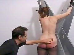 Ass in black pantyhose spanked hard