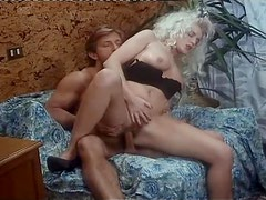 Two hot brunettes share a cock after sucking it ardently