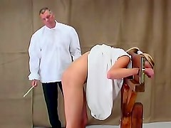 Young girl in stockades caned on ass
