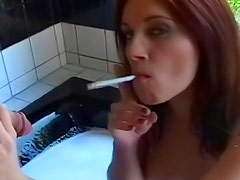 Redhead smokes and sucks cock in bathtub