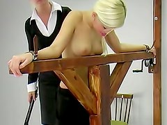 Flogging her back makes her hurt