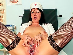 Nurse in naughty fishnets masturbates cunt