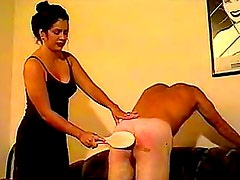 Mistress really gets into spanking him