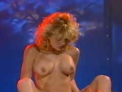 Retro video with curly blonde riding big black cock