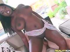 Big natural black titties bounce as she rides dick