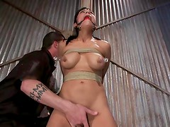 Tied up sub gets gag in her mouth from her dominant master