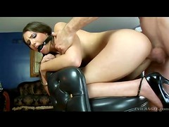 Ball gag on a bent over whore taking it from behind