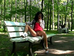 Chick in sexy sunglasses flashes outdoors