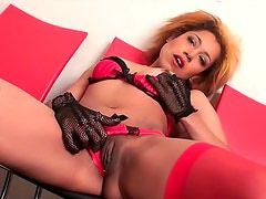 Skinny girl in gloves masturbates her hot cunt