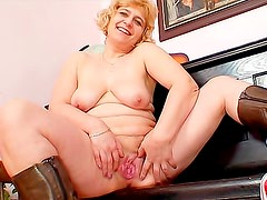 Masturbating mature plays the piano naked