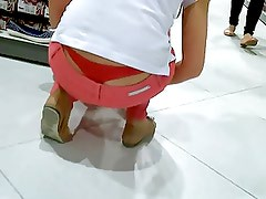 Girl working - Red Thong Slip view :-)