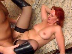 In boots and stockings she takes dick in the cunt