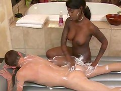 Ebony masseuse massaging client and sucks his cock