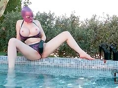 Latex bikini and gloves on chick in pool