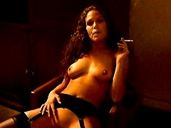 Girl with long curly hair smokes solo