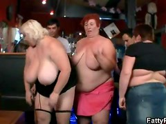 Fat women share their huge tits in the bar