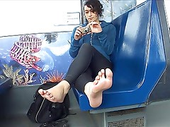 Teen Girl gives a Footshow in Train